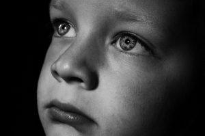 Sad face of child.