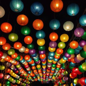 Colorful Chinese lanterns hanging over a tunnel.