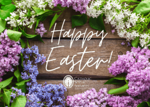 "Photo of spring flowers with ""Happy Easter"" written in center"